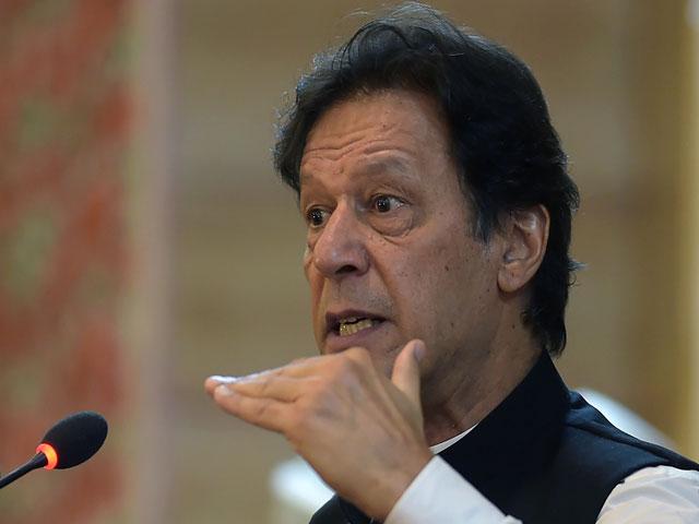 Prime Minister Imran Khan addresses the legislative assembly in Muzaffarabad on August 14, 2019. PHOTO: AFP
