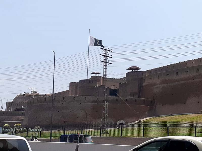 The Pakistani flag flies at half-mast on the Bala Hissar Fort. PHOTO: AFP