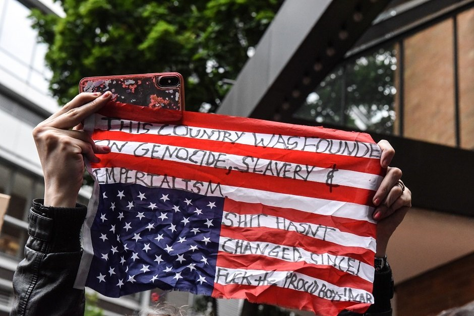 a masked counter protester attends an alt right rally in portland photo afp