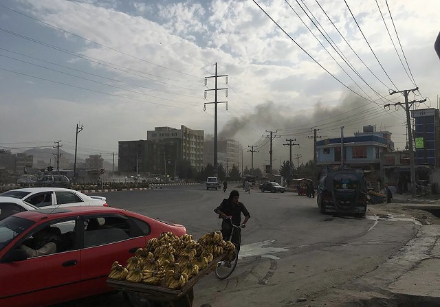 Smoke rises from the site of an attack targeting the Kabul office of the running mate of Afghan President Ashraf Ghani in Kabul on July 28, 2019. - At least one person was killed and 13 others wounded in an attack July 28 targeting the Kabul office of the running mate of Afghan President Ashraf Ghani, officials said. PHOTO: AFP
