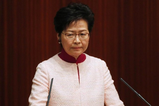 beijing says it firmly supports hong kong leader