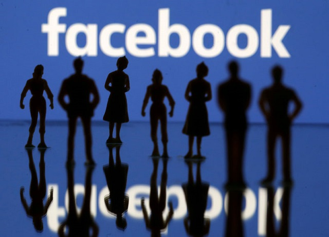 Small toy figures are seen in front of Facebook logo in this illustration picture, April 8, 2019. PHOTO: REUTERS
