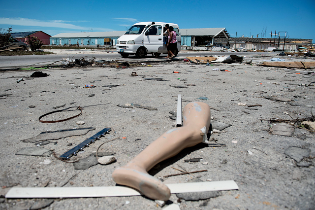 the leg of a dismantled mannequin is seen next to damage caused by hurricane dorian on september 5 2019 in marsh harbour great abaco island in the bahamas photo afp