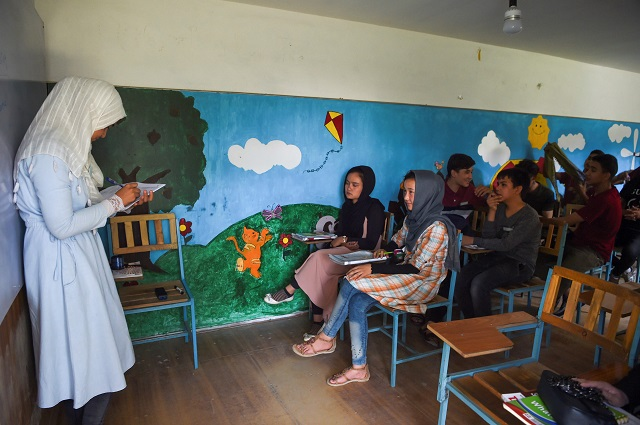 a teacher teachers her class in an institute in kabul photo afp
