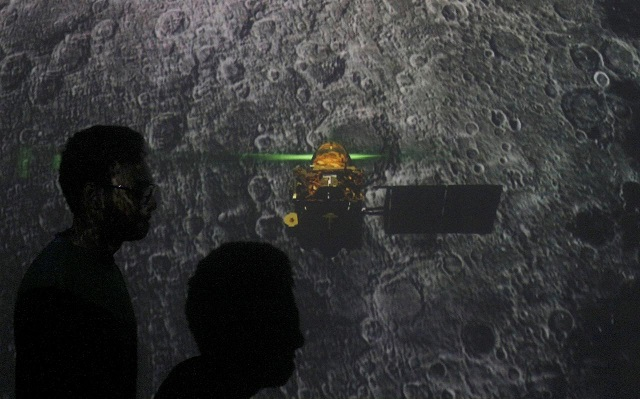 student-walk-past-a-screen-during-a-live-streaming-of-chandrayaan-2-landing-at-an-educational-institute-in-mumbai-india-september-7-2019-photo-reuters
