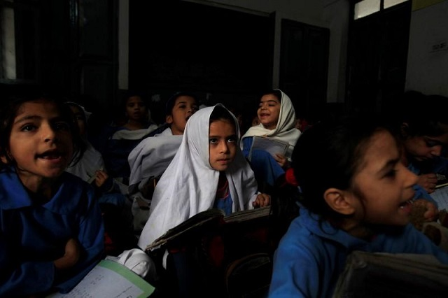 A girl attends her daily class with others at a government school in Peshawar October 29, 2014. PHOTO: REUTERS/FILE
