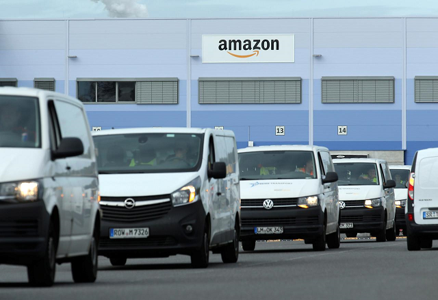 delivery vehicles leave an amazon logistics centre in mannheim germany september 17 2019 photo reuters