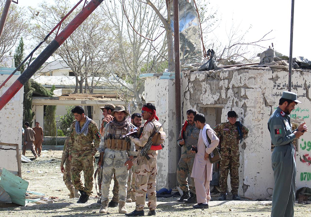 afghan security forces stand at the site of a car bomb attack in qalat capital of zabul province afghanistan september 19 2019 photo reuters