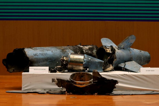 Remains of the missiles which Saudi government says were used to attack an Aramco oil facility, are displayed during a news conference in Riyadh, Saudi Arabia. PHOTO: Reuters