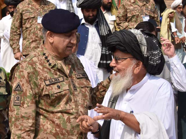 general qamar interacts with a tribal elder during his visit to miranshah on friday photo ispr