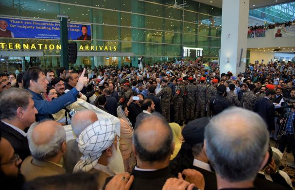 Prime Minister Imran Khan addresses supporters at Islamabad airport.