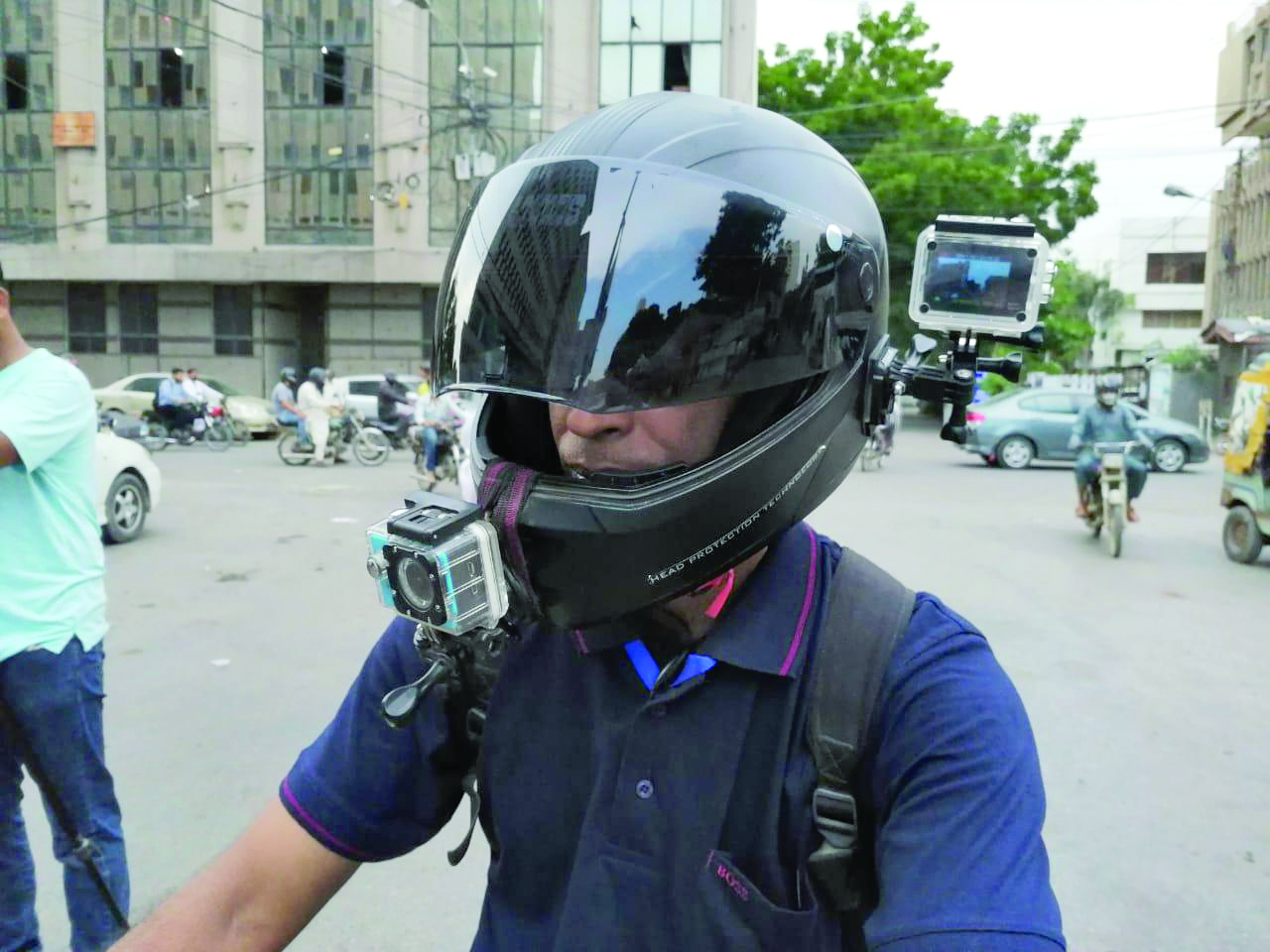 abdul qudoos takes his followers along on a ride across some of the city s most ghettoised neighbourhoods through the two cameras which he has retrofitted on his helmet photo express