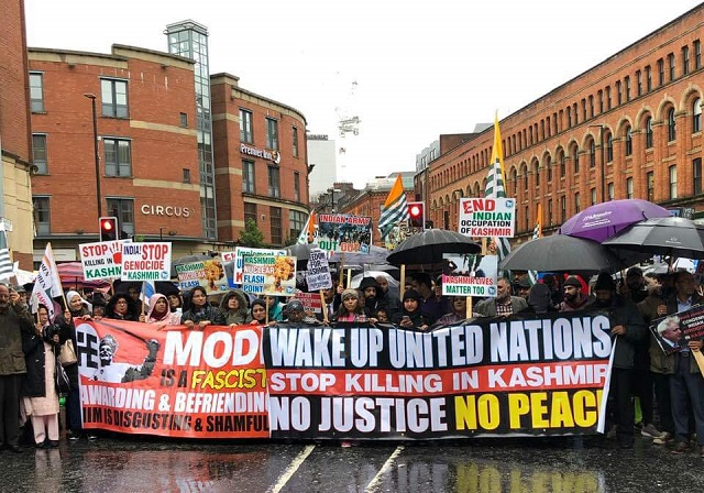 British Kashmiris, Pakistani protesters demand world community help stop rights abuses in occupied region. PHOTO: EXPRESS