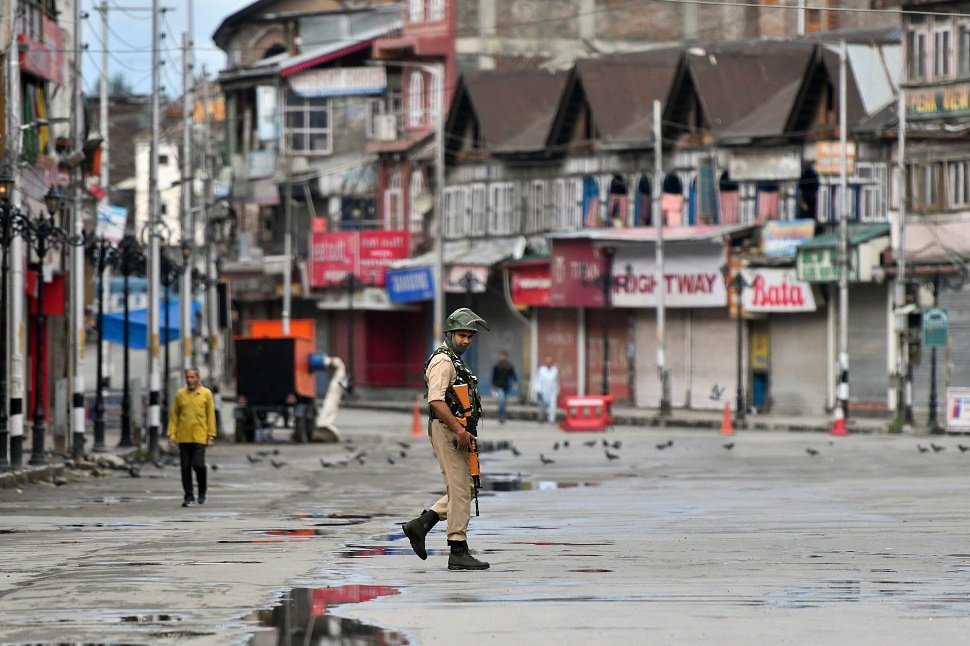 an indian security personnel patrols a deserted street in indian occupied kashmir photo afp