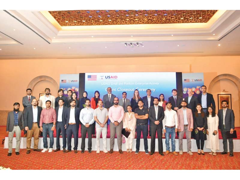 Challenge Fund grant recipients stand along with USAID Mission Director Julie Koenen at the grants closing ceremony held in Islamabad. PHOTO: EXPRESS