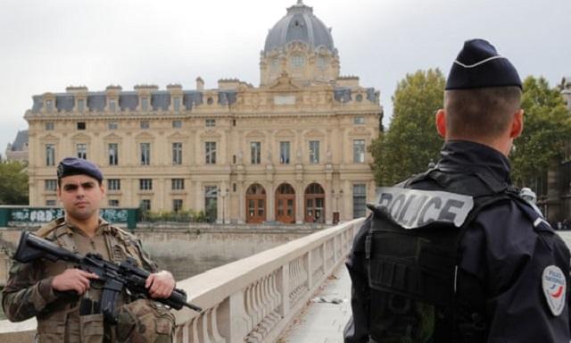 four police killed in paris stabbing attacker shot dead