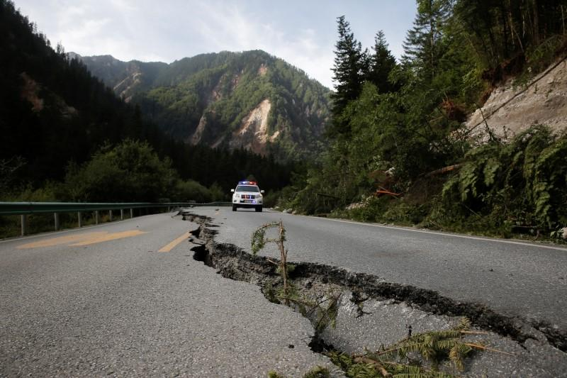 a file photo of a crack running through a mountain road after an earthquake photo reuters
