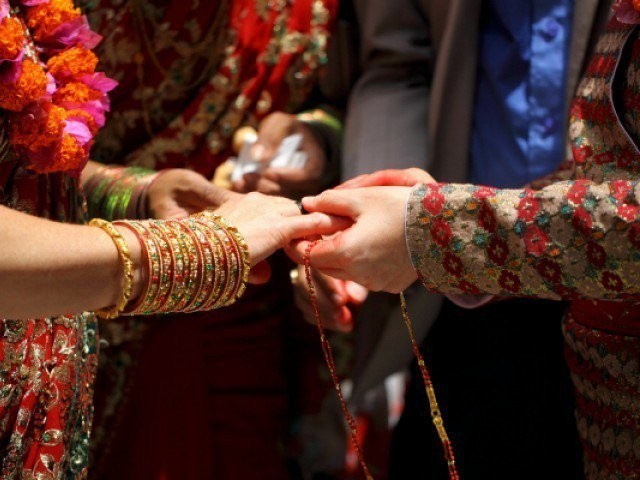 Newly-weds complain about 'unnecessary' interference of local police in the wedding. PHOTO: REUTERS/FILE