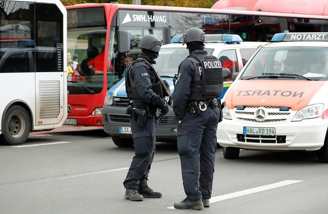 police officers stand guard near the site of a shooting in which two people were killed in halle germany october 9 2019 photo reuters