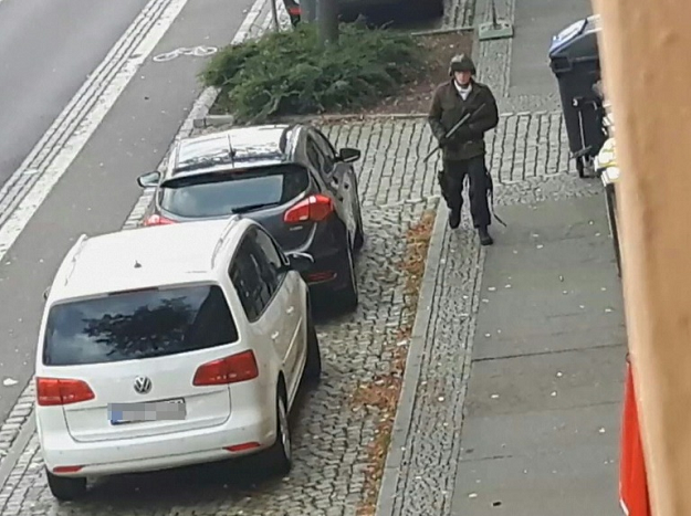 A video screenshot shows an armed man in the streets of Halle on Wednesday. PHOTO: AFP