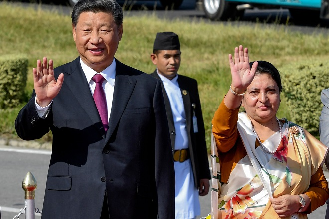 nepal 039 s president bidhya devi bhandari r and china 039 s president xi jinping l wave as the latter bids farewell wrapping up his two day visit to nepal photo afp