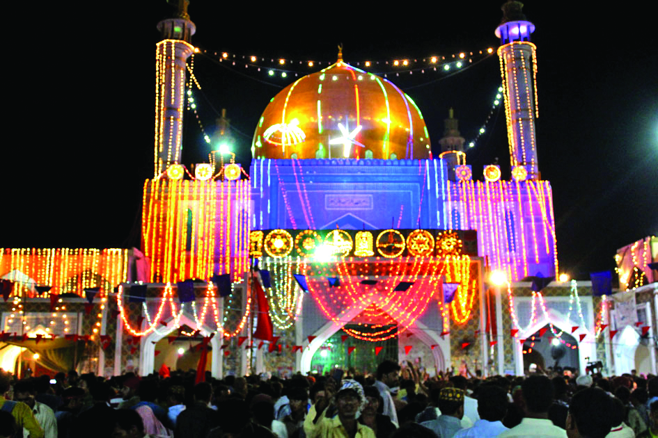 thousands of devotees gather at 13th century sufi saint lal shahbaz qalandar s shrine in sehwan each year photo file