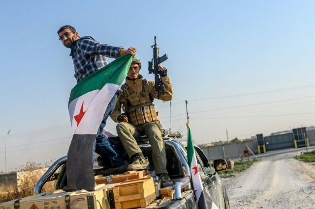 kurds announce deal with damascus as turkey pushes deep into syria