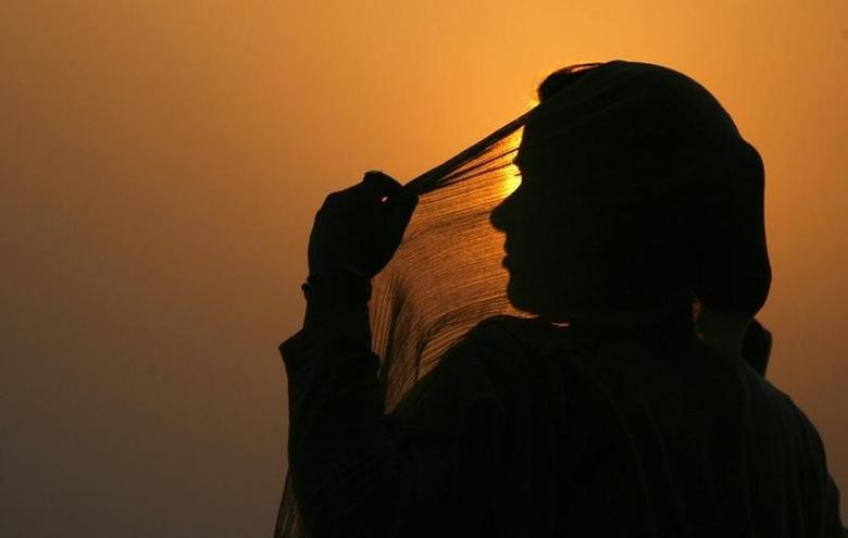 a reuters file photo showing silhouette of a woman