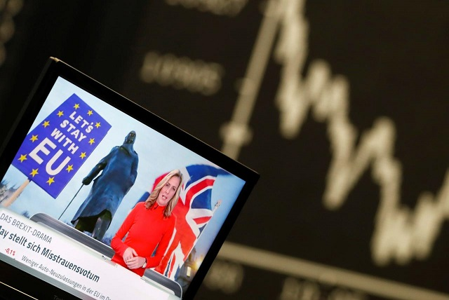 A TV screen is seen next to the German share prize index DAX board the day after the Brexit deal vote of the British parliament during trading at the stock exchange in Frankfurt, Germany. PHOTO: REUTERS/FILE
