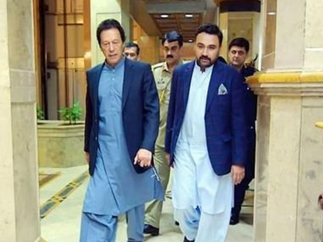 Babar bin Atta with Prime Minister Imran Khan. PHOTO: TWITTER