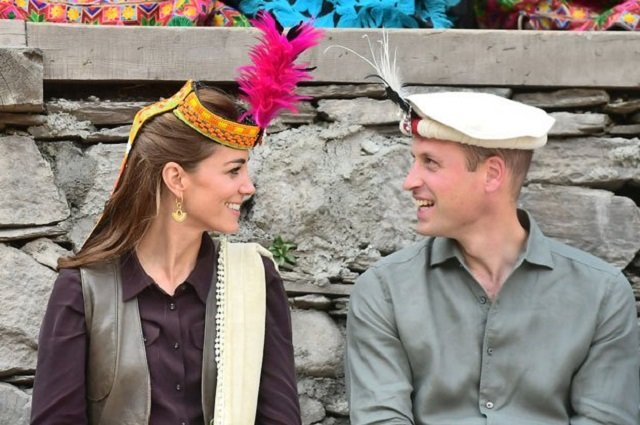 Britain's Prince William and Kate Middleton, Duchess of Cambridge, look at each other while visiting a settlement of the Kalash people in Chitral, Pakistan. PHOTO: REUTERS