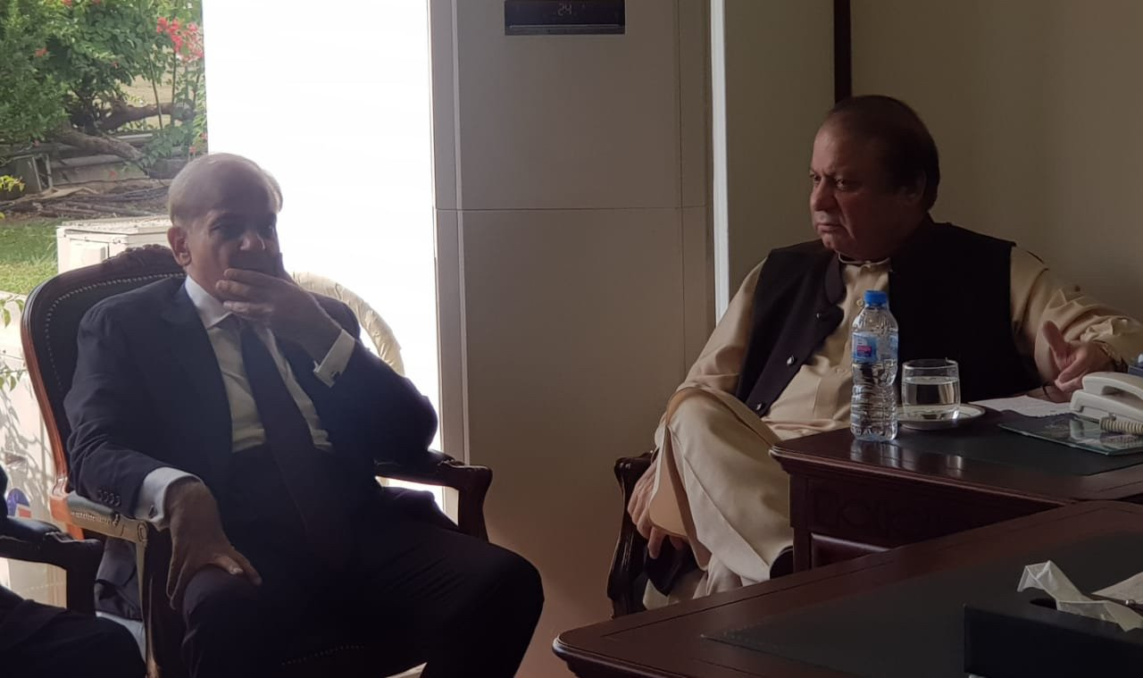 File photo of Sharif brothers at opposition leader's chambers in NA. PHOTO: EXPRESS