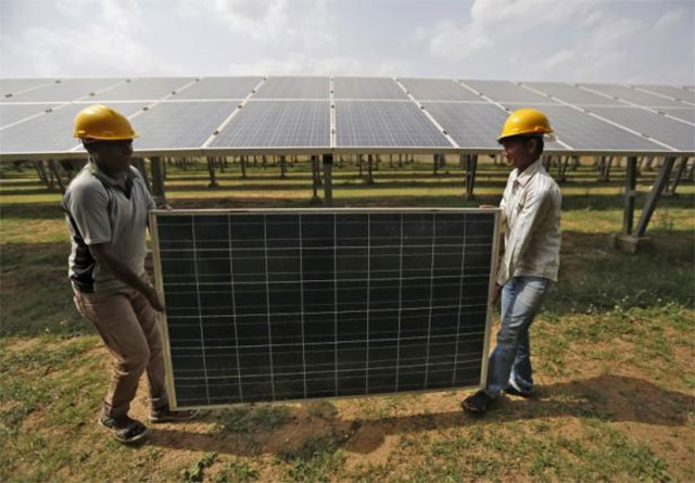 New Delhi continues an ambitious programme to reduce the country's dependence on fossil fuels. PHOTO: REUTERS