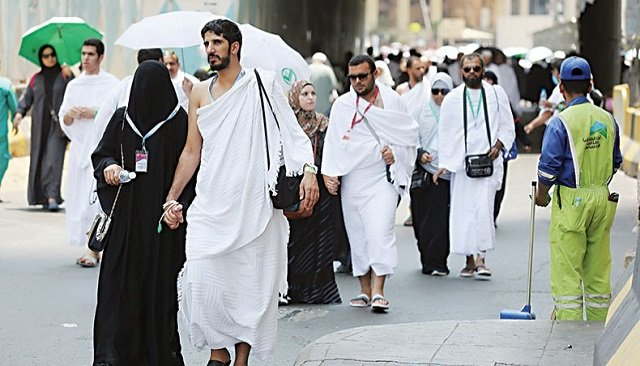 Pilgrims walk on a street in Makkah during the first day of Hajj. PHOTO: AFP/FILE
