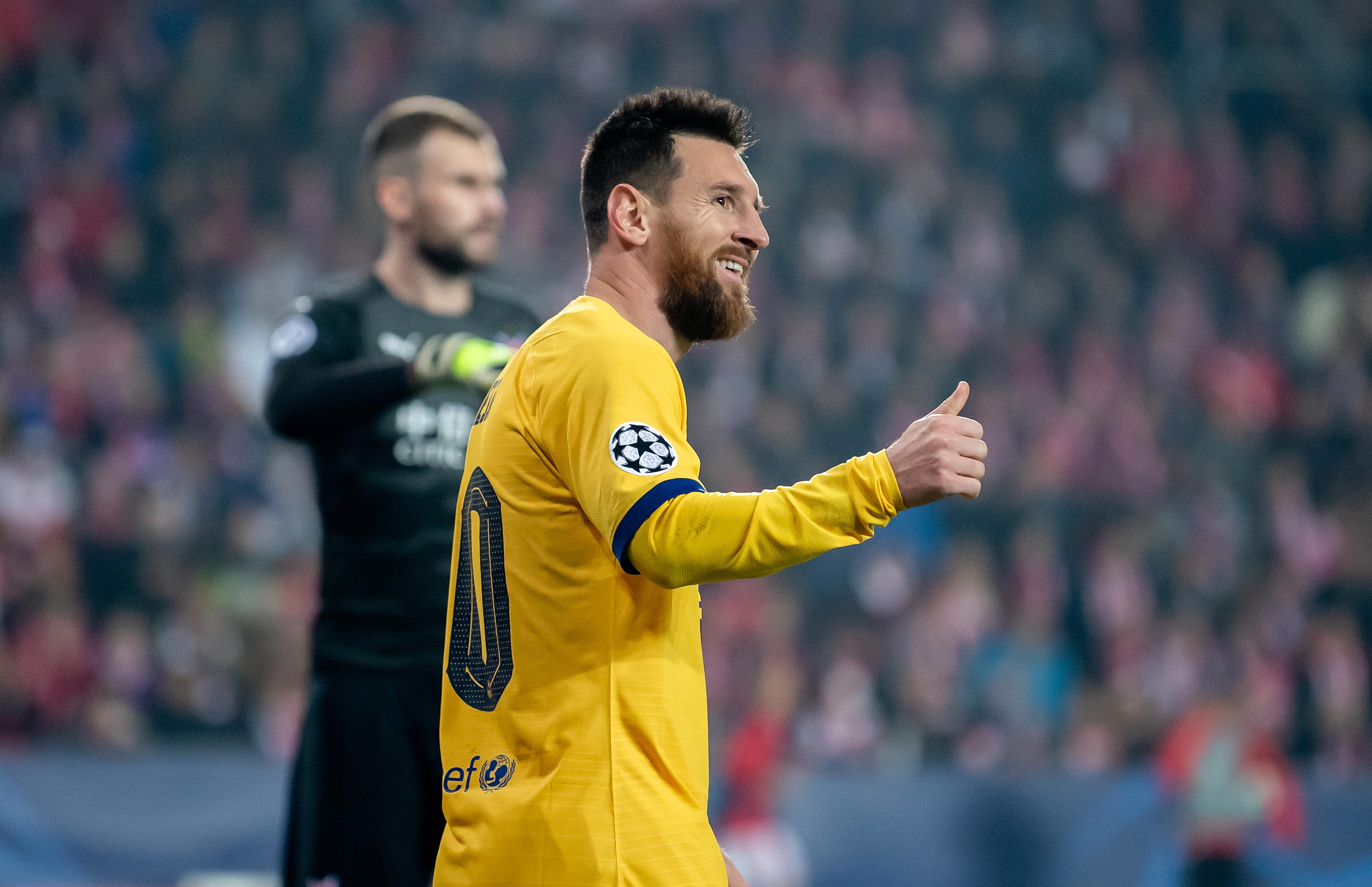 messi s historic goal helps barcelona edge slavia prague