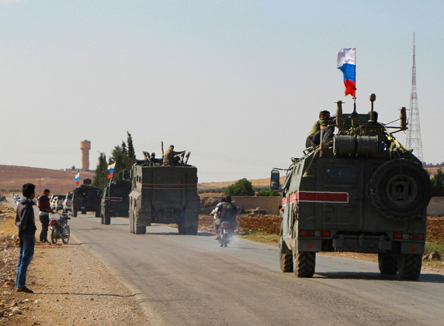 us to boost troops protecting syrian oil as kurds start pullback