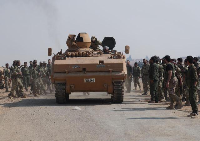 russia tells turkey kurdish fighters have left ne syrian border area erdogan