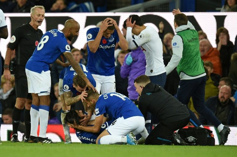 gomes suffers horror ankle injury devastated son sees red as everton deny tottenham
