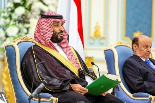 A handout picture provided by the Saudi Royal Palace on November 5, shows Saudi Crown Prince Mohammed bin Salman (left) and Yemen's President Abedrabbo Mansour Hadi. PHOTO: AFP