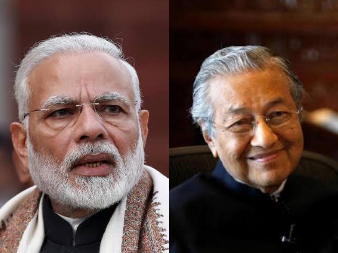 Reuters file photos of Indian Premier Narendra Modi [L] and Malaysian Prime Minister Mahathir Mohmad.