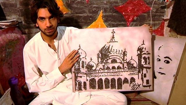 Ahmed Ali Sadiq makes an artwork of Gurdwara Darbar Sahib to commemorate 550th birth anniversary of Baba Guru Nanak. PHOTO: EXPRESS