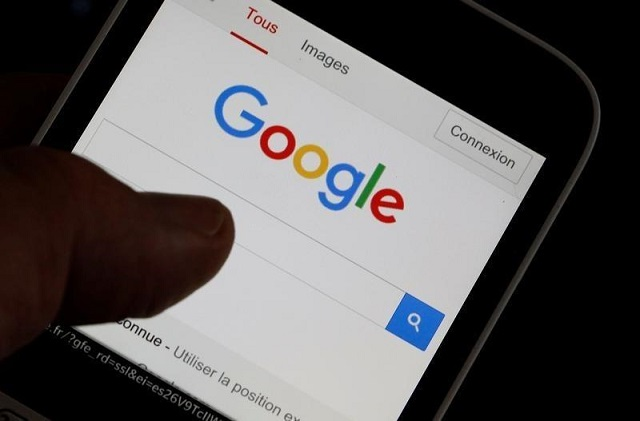 A man holds his smartphone which displays the Google home page, in this picture illustration taken in Bordeaux, Southwestern France, August 22, 2016. PHOTO: REUTERS