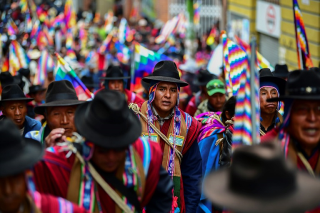 """Supporters of Bolivian ex-president Evo Morales, who has accused the new interim leader of orchestrating a """"coup"""". PHOTO: AFP"""