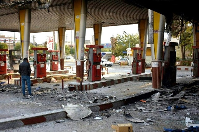 An Iranian man checks a scorched gas station that was set ablaze by protesters during a demonstration against a rise in gasoline prices in Eslamshahr, near the Iranian capital of Tehran, on November 17, 2019. PHOTO: AFP