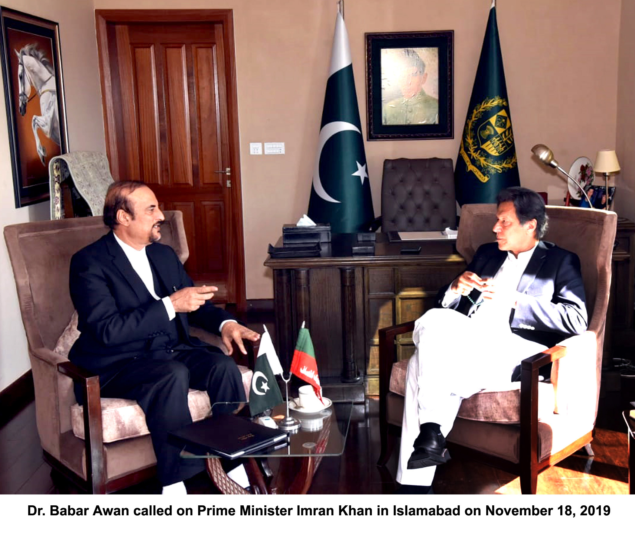 Dr. Babar Awan calls on Prime Minister Imran Khan in Islamabad on Monday. PHOTO: PID