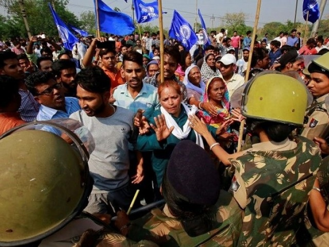 political row in indian state sparks debate on land rights for dalits
