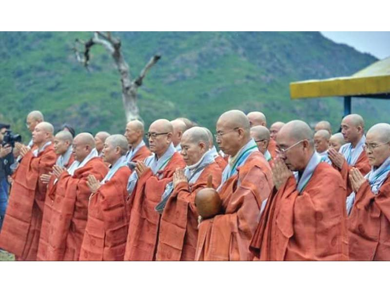 Buddhist monks from Korea perform a ritual at a historical site in Haripur. PHOTO: EXPRESS