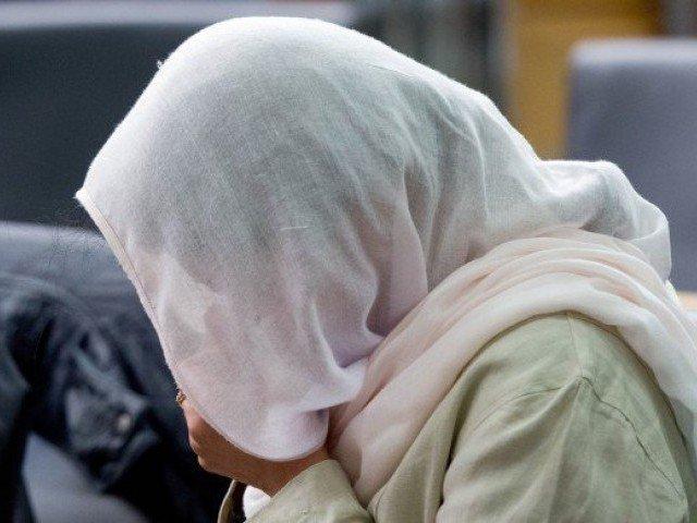 woman dumps two children into water tank attempts suicide