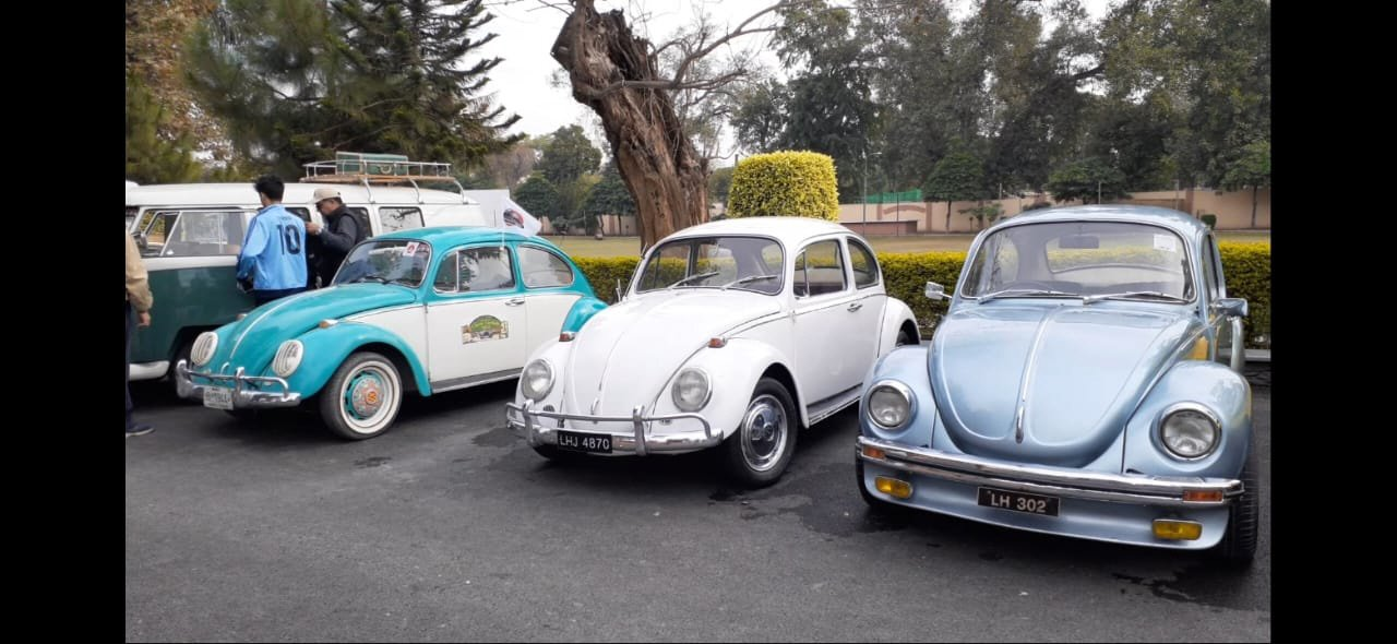 vintage classic cars caravan sets off