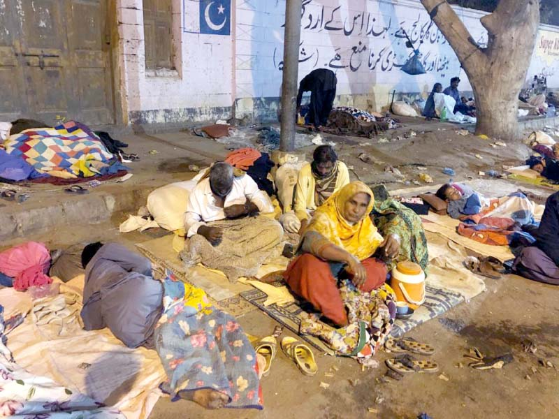 patients and attendants coming to the siut for dialysis have been living roadside opposite the facility for years as they have nowhere else to go photos express